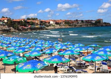 Sozopol/Bulgaria - 09.01.2012: Beach with umbrellas with Sprite logo in Sozopol, Bulgaria, and the town in background
