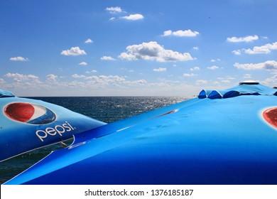 Sozopol/Bulgaria - 09.01.2012: Blue umbrellas with Pepsi logo with sea and sky background