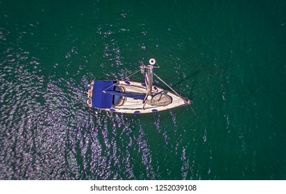 Sozopol/Bulgaria-july 13 2017:Aerial birds eye view from drone of yacht in deep blue sea.Sozopol ,Bulgaria