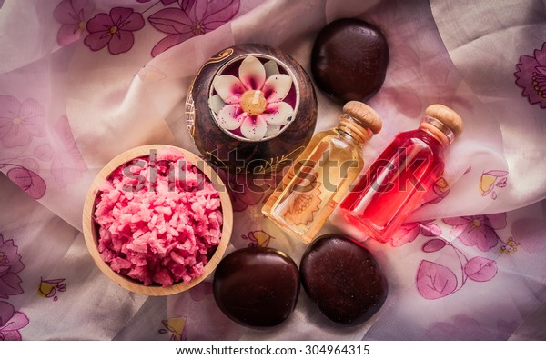 Spa & aromatherapy concept, spa sea salt with candle aroma in the vintage style.(soft focus with dark tones)