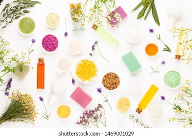 Spa aromatherapy floral background, flat lay of various beauty care products decorated with simple chamomile flowers.