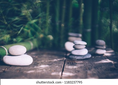 Spa background with bamboo and stones on an old wooden table. Japanese style. Simplicity, Zen, relax, calm and peaceful mood. Spa concept.Copy space