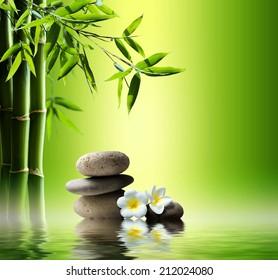 fondo spa con bambú y piedras en el agua