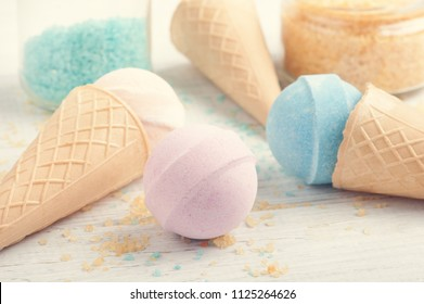 Spa background with bath bombs in waffle cones, aromatherapy salt