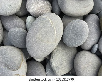 Spa background with grey stones, gray modern background, pile of beach gray stones