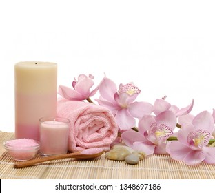 Spa background with lying on rose with salt in bowl, towel, candle