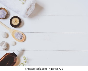 Spa background of oil, towel and candles. Top view