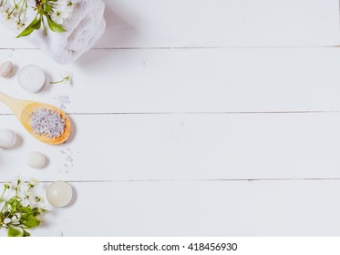 Spa background with towels, flowers and candles. Top view