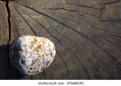 Spa beautiful and unusual decorative pebbles on the old cracked wooden background