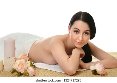 Spa beautiful Woman on a bamboo rug