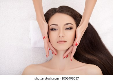 Spa. Beautiful Young Woman Getting a Face Treatment at Beauty Salon.