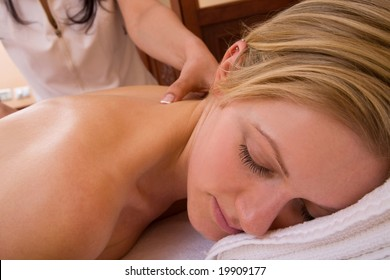 spa and beauty concept with a woman having a massage session