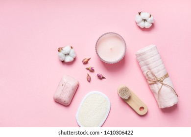Spa, beauty cosmetics and body care treatment concept with copy space. Creative top view flat lay composition with bath accessories, organic rose soap on pink background