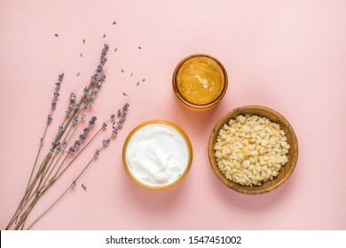Spa, beauty cosmetics and body care treatment concept. Creative top view flat lay composition with gel face mask, body cream,sea salt and organic lavender flowers.