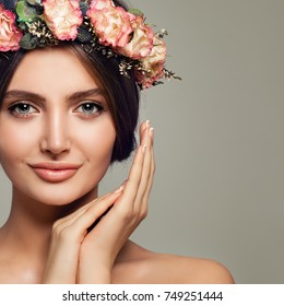 Spa Beauty. Cute Woman Spa Model with Healthy Skin and Sweet Flowers. Beautiful Girl Smiling on Background with Copy space