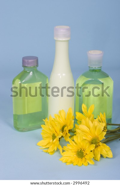 Spa beauty kit - bottles of lotions with flowers
