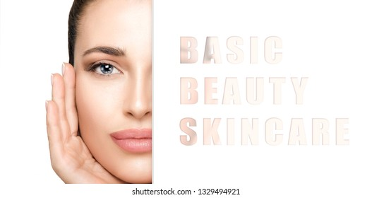 Spa Beauty and Skin Care concept. Beautiful brunette woman with healthy skin and natural no makeup makeup. Half face close up cropped beauty portrait with a white sign with the text