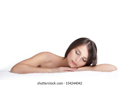 Spa beauty skin treatment woman on white towel. Woman with perfect skin lying on towel. Young woman in 20s isolated on white background.
