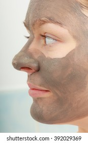 Spa beauty treatment and skin care. Closeup part of female face with clay mud facial mask.