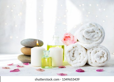 Spa, beauty treatment and wellness background Towel Cosmetic Massage oil, flowers and candel