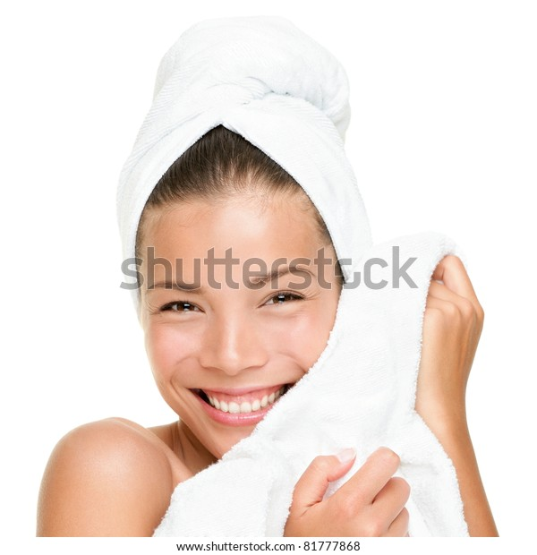 Spa beauty treatment woman smiling happy feeling soft towel on face. Closeup of beautiful cute mixed race Chinese Asian / Caucasian female model with perfect skin. Girl isolated on white background