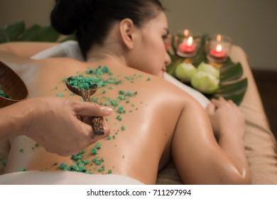 Spa body massage treatment. Beautiful woman in spa salon having spa  therapy
