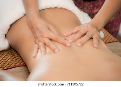 Spa body massage treatment. Beautiful woman in spa salon having spa  therapy