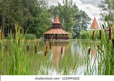 Spa Bojnice, Slovakia, Europe. Tower restaurant in garden park on lake.