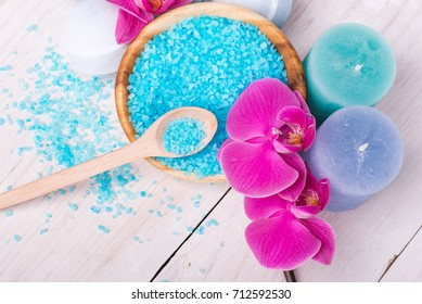 Spa candle and salt. Cosmetic treatment for beauty. Natural aromatherapy. Healthy bath, health care, wellness. Nature for body, relax. Flower branch, petals of spring sakura