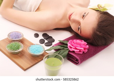 Spa. Care Facial. Beautiful young woman relaxing in the spa salon.