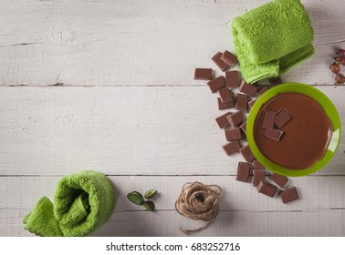 Spa of chocolate aromatherapy on white boards top view.