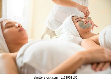 Spa Clay Mask. Woman with clay facial mask in beauty spa. Skincare. Beauty Concept. Cosmetology. Body care girl's