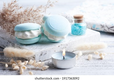 Spa composition with bath bomb macaroon and dry flowers on rustic background in monochrome style. Candles and salt. Beauty treatment and relax