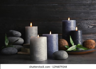 Spa composition with burning candles on table