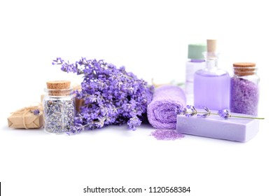 Spa composition with flowers of lavender, cream, salt and soap on white background
