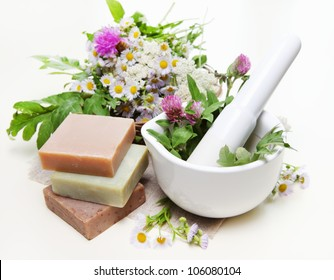 Spa Composition with Herbs, Mortar and Homemade Soap