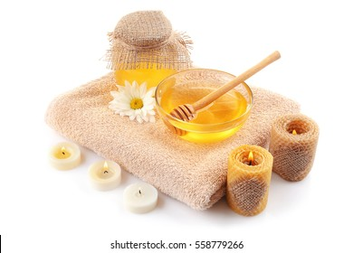 Spa composition with honey on white background