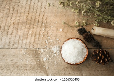 Spa composition on wooden table. Natural aroma candle, sea salt on rustic wooden background. Healthy skin care. SPA concept. Top view with space for text