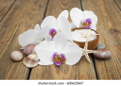 Spa composition with orchids on wooden background