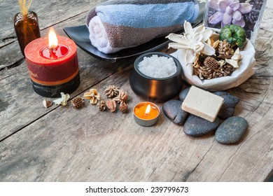 Spa composition. Sea salt, candle , essential aroma oil on woode