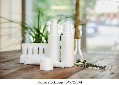 SPA composition. Set of copyspace cosmetic bottles and tubes. Face/body care concept: bottles of creams/lotions/serums. Selective focus, sallow DOF, close up.