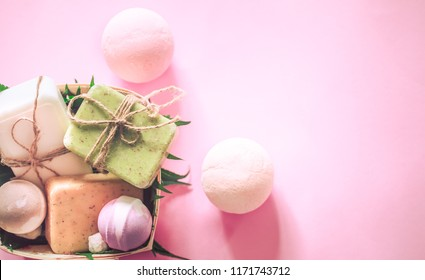spa composition soap with salt bombs on a pink background, the concept of relaxation and body care