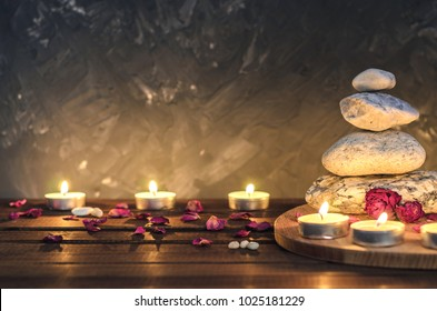 Spa composition-stones, candles, aromatherapy, dry flowers.