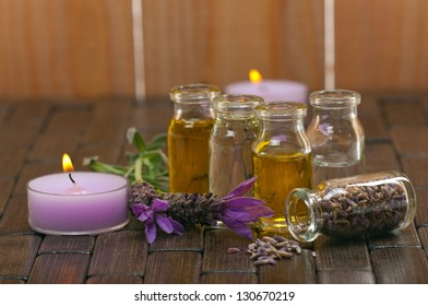 Spa concept with with aromatic lavender, candles and massage oils