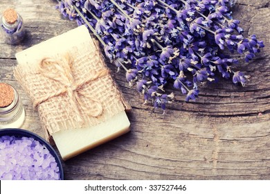Spa concept : lavender soap on wooden background