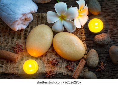 Spa concept with organic soap and burning candles in the dark