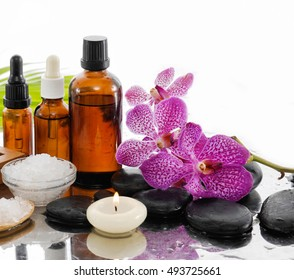 spa concept with palm ,towel, salt in bowl ,stones, candle,oil