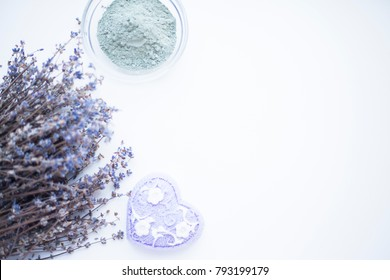 Spa concept. Soap, lavender and clay on the white background. Top view. Space for a text.