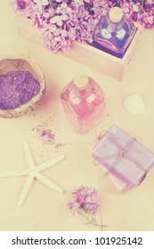 Spa concept - soap, pink essential oil, lilac, bath salt and starfish