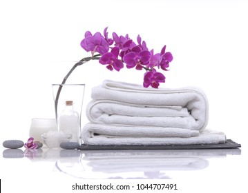 Spa concept with towel, pink orchid,stones, oil salt in bowl